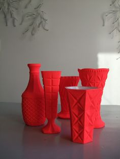 neon painted glass vases from Pimpelwit, via Apartment Therapy. Love the matte look, with the white glossy interior.