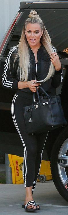 Khloe Kardashian: Purse – Hermes  Jacket, pants, and shoes – Adidas