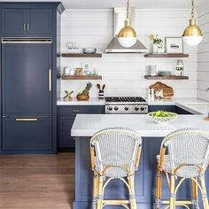 Antique Brass Pendants Over Navy Blue Kitchen Peninsula