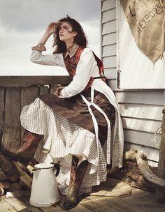 Wild West style: Maison Margiela polyester sleeveless top, MM6 cotton dress, Theory cotton mix shirt, Gasa cotton skirt, Vivienne Westwood Gold Label polyester taffeta skirt, Jessie Western leather Bird boots