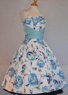 From my own Horrockses collection, a lovely blue floral cotton cocktail dress with a wrap-around cummerbund/sash. Skirt has unfortunately been cut down from its original length, but it's still a beauty!