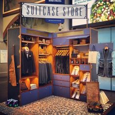 They've created a mini boutique within a small booth space. The rug defines the space and the walls allow the vendor to merchandise the product and show shoppers how to pair them together.
