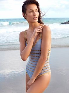 Sana One Piece Swimsuit | Artisan handmade cotton crochet one piece swimsuit featuring contrast striped detail and straps. Delicate button details on the side and a cheeky fit.