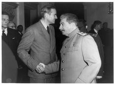 """Ambassador Averell Hariman shakes hands with Stalin during the Postdam Conference (July-August 1945). A new yorker and a businessman, Harriman served as US ambassador to the USSR from 1943 to 1946. He was one of the first to warn about the European ambitions of the Soviet Union. A fan of George Kennan's """"Long Telegram"""", Harriman became one of the architects of Truman's policy towards the USSR."""