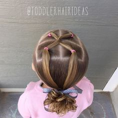 "Today I did a simple but elegant elastic style - one front ""cross over and back"" pulled into a low messy bun."