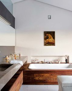 Codo a Codo Arquitectura Madrid remodel bathtub wood stone gray plaster coral modern classic