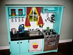 Another awesome retro-ish play kitchen made from an old entertainment center!