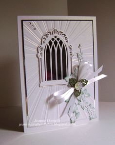 This little card is using the Dazzling Sunburst embossing folder, with a Spellbinders Arched Window and Creative Expressions / Sue Wilson's Ivy,   Complete Petal Leaves and Dazzler.
