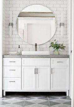 concrete countertops white bathroom with circular mirror