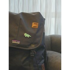 At the airport! For everyone asking we'we off to Barbados you might spot something new in this photo...   #Patagonia #travels #airportstyle #designosaur #rucksack #backpack #dinosaur #triceratops #pingame #enamelpin #enamelpins #airportfashion