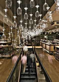 Universal Design Studio / Speirs + Major London - A luminous installation at Hedonism Wines comprises inverted sommelier glasses tipped with LEDs at the base of their stems.
