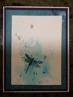 Brusho background with dragonfly stamp