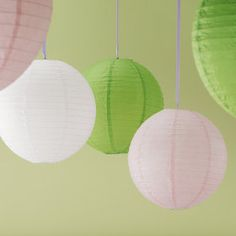 Green and white lanterns with coral color incorporated through out.