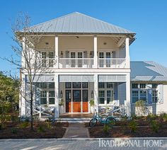 A two-level porch spans the front of this Florida home. - Photo: Jean Allsopp