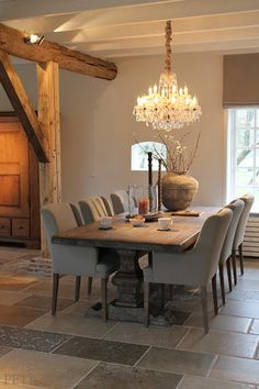 putty upholstered dining chairs and gorgeous taupe walls - Belgian style!