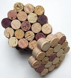 These cork coasters would be easy to make, just chop in half, glue together, and bind with fabric strip of your choice.