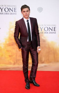 Zac Efron wears a George Clinton Suit to the German premiere of 'The Lucky One' at Cinemastar at Potsdamer Platz Square in Berlin on April 25th, 2012