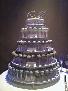 cake pop wedding cake It's pretty but idk how I feel about having cake pops for a wedding cake