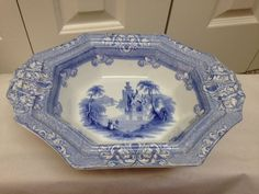 """Beautiful antique piece. J & G Alcock - Cobridge """"Cologne"""" pattern. Light blue transferware from the mid 1800's. Footed server/serving bowl. Minor chip on the underside of one of handles; other handle underside has a larger chip.   eBay!"""