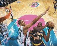 Tim Duncan defends against Shaquille O'Neal during Game 3 of the Western Conference Finals between the San Antonio Spurs and Los Angeles Lakers on May 19, 1999 in San Antonio.