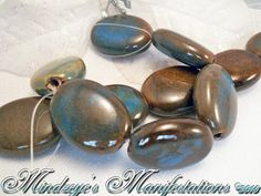 17x15mm Beachside(Dark Aqua/Honey) Glazed Porcelain Puffed Oval Beads' Receive 1 15- inch strand.   Each bead is unique due to glazing. Great Focals or accents. Excellent summer colors. Beach side sand with the waves lapping at the your feet.