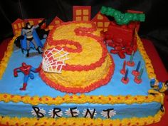 """Like the """"age"""" as 2nd tier, can skip a """"number candle"""". Cute super hero cake idea."""