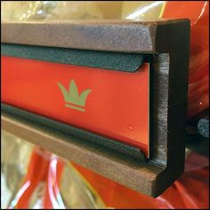 Yes you can create C-Channel in Wood. Here the designer goes well beyond with a Embedded Metal-in-Wood C-Channel Label Holder. Retail Fixtures, Retail Design, Sign Design, Pos, Visual Merchandising, Chevrolet Logo, Signage, Bakery, Shelf