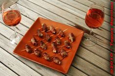 Dates filled with Goats' Cheese and wrapped with a strip of Streaky Bacon