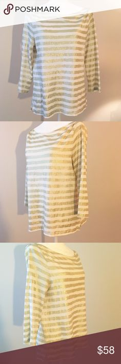 J.Crew Shiny Gold & Cream Striped Long Sleeve Top 🎁Offers welcome 🔑Bundle to save                                             👍Like for price drop notifications                EUC J.Crew super glittery striped long sleeve t-shirt. Beautiful warm gold & cream thick stripes. Absolutely gorgeous under the sunlight so it's perfect for summer! ✨Runs true to size. Can also fit an XS-S. 100% cotton. Tops Tees - Long Sleeve