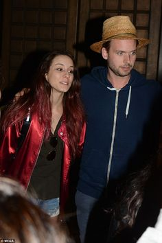 Blending in? Loved-up newlyweds Pretty Little Liars' Troian Bellisario and Suits' Patrick J. Adams sport laid-back looks as they were spotted on their honeymoon in Sydney on Monday