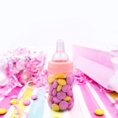 Create a sweet baby shower favor treat with mini baby bottles  and candy.  #girlbabyshower