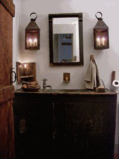 Primitive Bath.  Looks great, but I would have either had hooks that looked like they were holding the lanterns or had them on a shelf.  That being said...this is soooo much better than my bathroom!