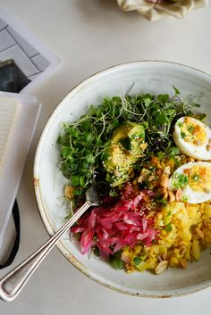 Rainbow Cauliflower Rice Bowl - Lightly cooked cauliflower is chopped, then tossed, with turmeric, cumin, cayenne, and a touch of ghee - add sliced avocado, hard-boiled eggs, toasted seeds, rainbow chard stems, lettuces.  - from 101Cookbooks.com