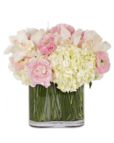 These arrangements would be great as Cocktail Table Centerpieces.  Tic Tock Couture Florals