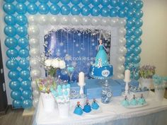 Dessert table and balloon backdrop at a Frozen birthday party! See more party planning ideas at CatchMyParty.com!
