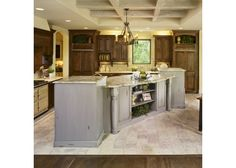 Large kitchen with wooden cabinets and large island-Home and Garden design ideas