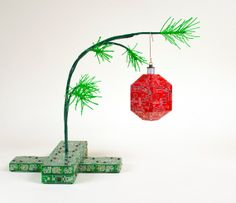 I loved the Charlie Brown Christmas special when I was a kid. So to pay an homage to my youth, I made the Charlie Brown Data Christmas tree. This sculpture is complete with bending tree being pulled down by a single bright red ornament. The pine tree needles are made from wire and are as sparse as the original cartoon tree.