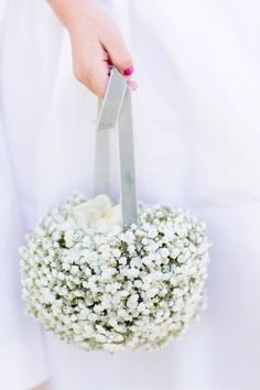 Baby's breath petal basket by bloomsbymarthaandrews.com | Read More: http://www.stylemepretty.com/little-black-book-blog/2014/08/12/classic-lake-tahoe-wedding/ | Photography: Jonathan Young - jyweddings.com