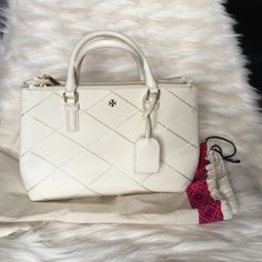 """Tory Burch Robinson stitched mini double zip tote not sure I'm selling so please ask if seriously interested Like new condition and only used a few times. Please note there are some marks as this is an ivory bag. I am able to send more photos for anyone seriously interested. Comes with strap to be worn as shoulder/cross body..23"""" and removable. Top handle is tubular 4.5"""" drop. Comes with dust bag. Beautiful stitching detail. From spring 2015. ❗️NO TRADES OR LOWBALLING❗️ Tory Burch Bags Totes"""