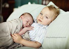 baby lying on big bro