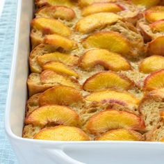 Overnight Peach French Toast Recipe Breakfast and Brunch with peaches, dark brown sugar, fresh lemon juice, french bread, large eggs, non fat evaporated milk, nonfat milk, pure maple syrup, bourbon whiskey, pure vanilla extract, ground cinnamon, kosher salt, greek yogurt, whipped cream, butter, powdered sugar, maple syrup