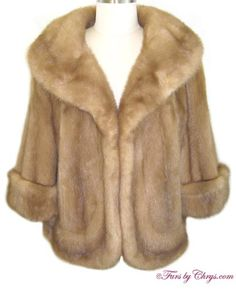 SOLD! Pastel Mink Jacket #PM783; Excellent Condition; Size range: 10 - 14 Average, Petite or Tall. This is a beautiful genuine natural pastel mink fur jacket. It has a Gross Furs label and features a large shawl collar and a horizontal pelt at the bottom hem for added interest. The sleeves are adjustable with cuffs to half-sleeves; or with the cuffs down, they are 3/4-length sleeves.  You will feel as glamorous as you look when you wear it!