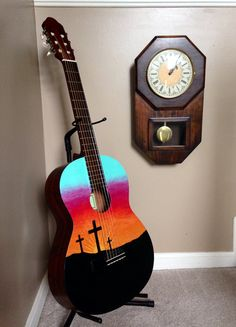 """Playable acoustic art called """"New Life"""" painted on a Eterna EC-12 by Yamaha.  * We love to do custom work, let us make your musical art dreams come true!"""