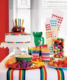 Childrens party spread with rainbow colored food and treat assortment