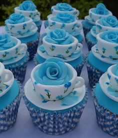 The most adorable cupcakes ever! Turquoise blossoms fill floral teacups perched atop blue gingham liners.