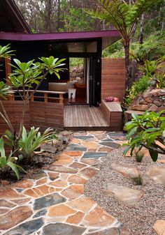 Stunning garden & deck in a tranquil setting. Love the mosaic stone path.