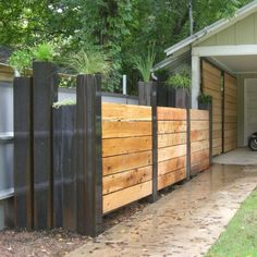 privacy fence for recycling i think. fence posts as planters!