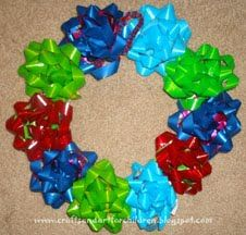 Don't throw away the Christmas Bows - have the kids turn them into a wreath keepsake to hang up as a decoration.