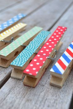 *Washi Tape Clothespins* ...This is very simple! Just cut a piece of washi tape the length of the clothespin. (You will have to trim the side a bit.) Then tape it down and smooth it out. Voila! A fancy clothespin that will add pizzazz to just about anything!