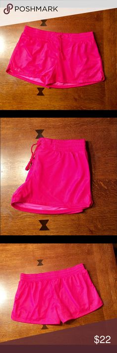 Women's Under Armour shorts! Super cute women's under armour shorts in pink.  Very soft fabric, heat gear technology. Breathable mesh.  100% polyester.  Waistband measures approx. 30.5 inches.  2 1/4 in inseam.  Semi fitted.  Cute waist band with tie.  Shorts have been worn 1-2 times but are in excellent condition. Under Armour Shorts